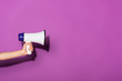 canvas print picture - cropped image of woman holding megaphone on purple background