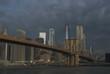 Brooklyn view of Manhattan skyline and Brooklyn Bridge on moody morning