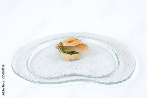 In de dag Buffet, Bar Canape with sturgeon on a glass plate.