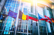 canvas print picture - Waving flags in front of European Parliament building, Brussels