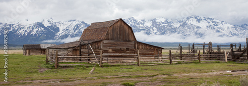 Fotografie, Obraz  Log Cabin Barn in front of Mountains in the Grand Teton National Park