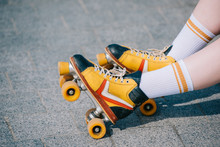 Close-up Partial View Of Female Legs In Vintage Roller Skates