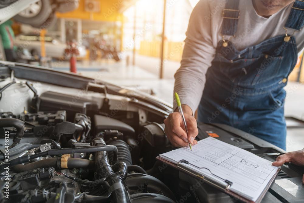 Fototapeta  mechanic at work in his garage