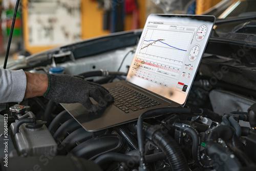 Fototapeta Professional car mechanic working in auto repair service. obraz na płótnie