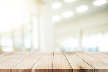 Wooden Table With Blur Background Of Office Room.
