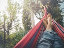 Nude Feet Relaxing On Hammock In Spring Season