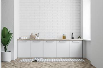 White kitchen counter, white brick wall