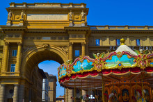 Carousel Of The Piazza Della Repubblica (Republic Square) At Foreground With The Arch At Background, In Florence, Italy.
