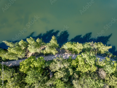 Spoed Foto op Canvas Khaki drone image. aerial view of rural area lake in forest with green water
