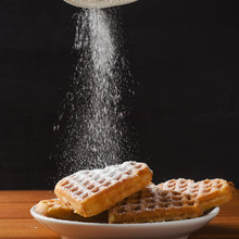 Homemade Waffles Heart On Plate. Sugar Powder Is Poured From The Strainer. Sweet Pastry.