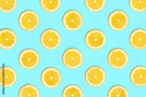 Foto op Aluminium Vruchten Colorful fruit pattern, Lemon slices on a pastel blue background. Top view.