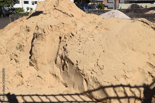 Monte de areia sombreado por uma grade de portão Canvas Print