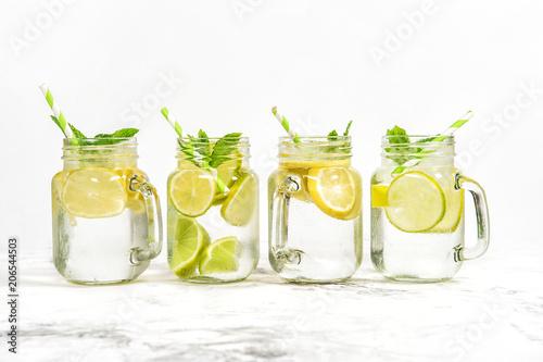 Obraz na plátně  Fresh drink  lime lemon mint ice Cold summer lemonade