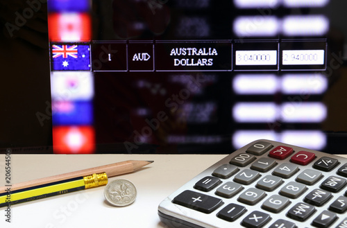 Five Cents Coin Of Australia And Calculator With Pencils On The White Floor And Digital Board