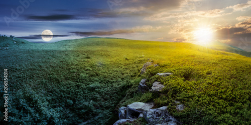 Foto op Aluminium Nachtblauw time change concept with sun and moon over panoramic landscape. lovely summer scenery with boulders among the grass. location Runa mountain, Ukraine