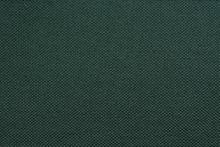 Texture Of Dense Dark Green Fabric Closeup