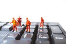 Miniature People, Engineers Team Standing On Computer Keyboard Using As Technology And Business Concept