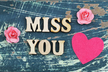 Miss You Written With Wooden Letters On Rustic Surface