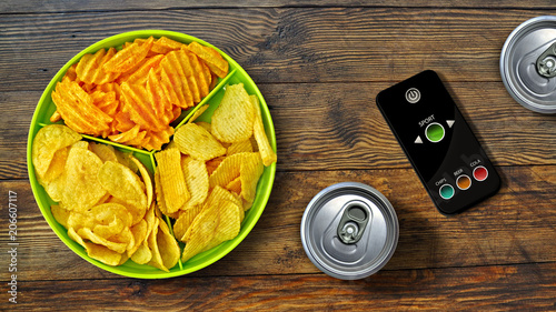 Fototapeta Set of football fan - chips - special remote control and drink obraz
