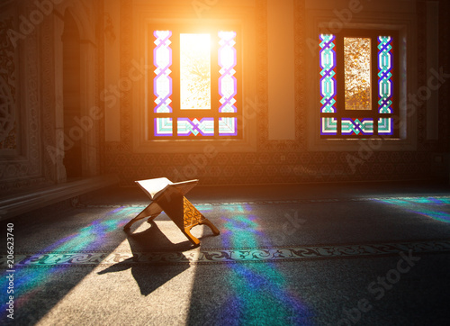 Fotografie, Obraz  Quran - holy book of muslims, scene in the mosque at Ramadan time