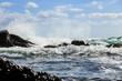 Waves crashing on the black rocks during the storm