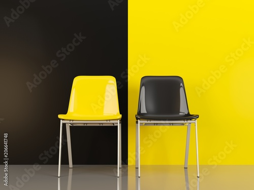 Two chairs in front of black and yellow wal Canvas Print