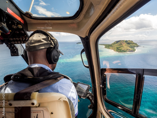 Türaufkleber Hubschrauber Aerial Landscape View from Inside Helicopter Looking Across Tropical South Pacific Island and Ocean Reef in Fiji