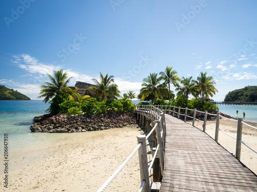 Ocean Landscape Boardwalk Walkway Over Beach out to Lone Palm Tree Island in Fij Tableau sur Toile