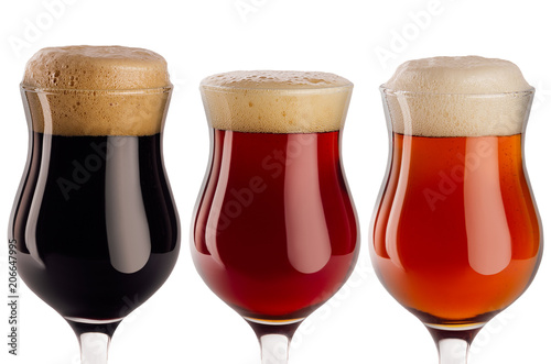 Papiers peints Biere, Cidre Set of different beer in wineglasses with foam closeup - lager, red ale, porter - isolated on white background.