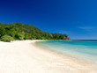 Beautiful Landscape of Reef and Turquoise Aqua Blue Clear Ocean Water with White Sand Beach and Palm Trees on Tropical Pacific Island of Fiji