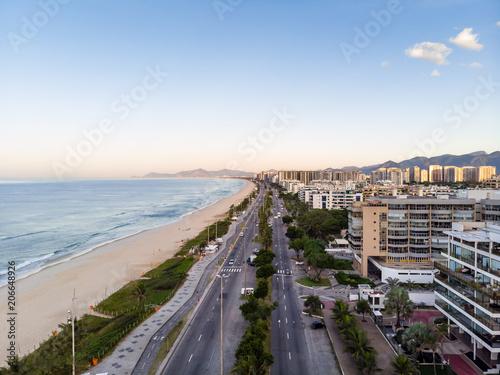 Poster Light pink Drone photo of sunrise in Barra da Tijuca beach and boardwalk, beachfront buildings catching the early light, Rio de Janeiro