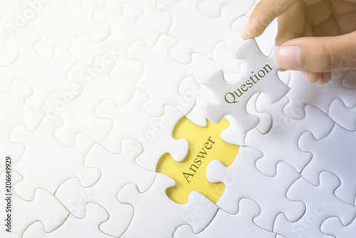 hand holding question and answer word on jigsaw puzzle Wallpaper Mural