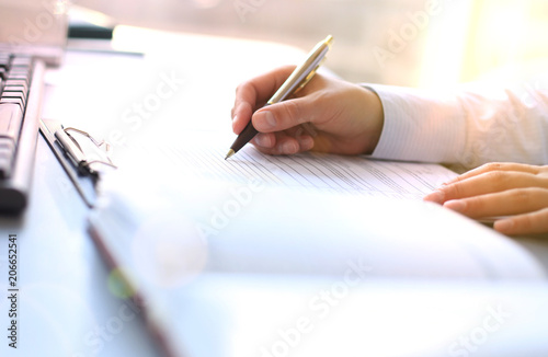 Fotografie, Obraz  Businesswoman hands pointing at business document.