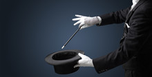 Illusionist White Hand Wants To Conjure With Magic Wand From A Black Cylinder Something