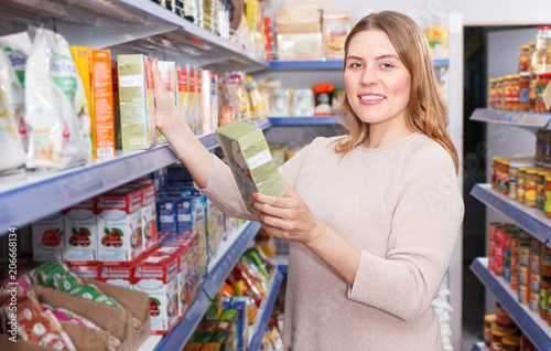 Poster Pharmacie Positive woman buyer with assortment of grocery food store