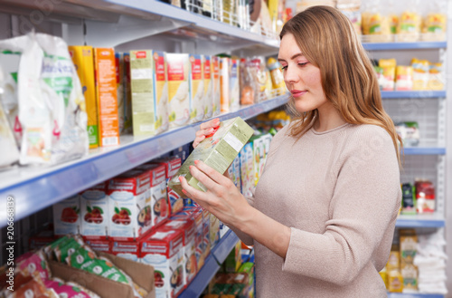 Poster Pharmacie Woman customer with assortment of grocery food shop