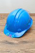 The word dad displayed with a blue hardhat