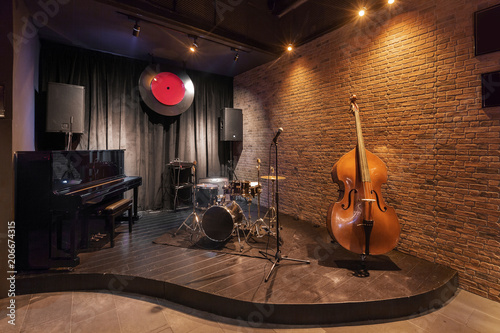 Modern jazz bar interior design, stage with black piano and cello Wallpaper Mural