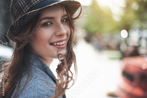 Pinturas sobre lienzo  Grinning attractive lady in trendy hat is having wind in hair