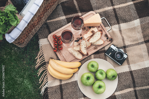 Recess Fitting Picnic Enjoy your dinner in the nature. Close up top view of organic food and wineglasses on the blanket near picnic basket