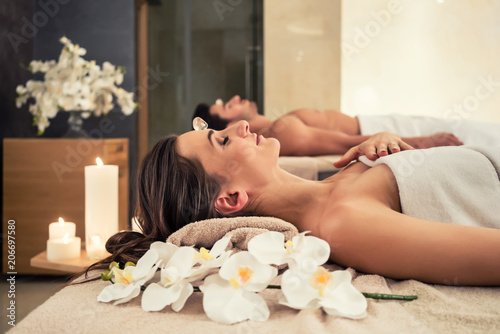 young-man-relaxing-with-his-partner-on-massage-beds-at-modern-spa-and-wellness-center