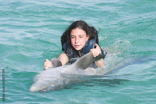 Fotografia, Obraz kid pretty young girl with doplhin in water park play and swim