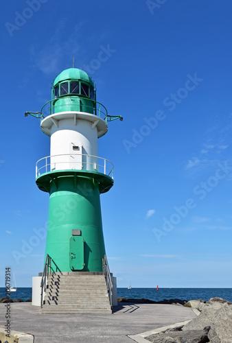 Foto op Aluminium Vuurtoren Lighthouse on the western pier in Warnemünde in Germany