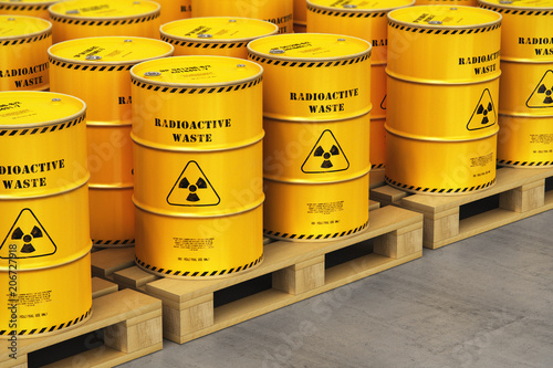Group of yellow drums with radioactive waste on shipping pallets in warehouse Fototapeta