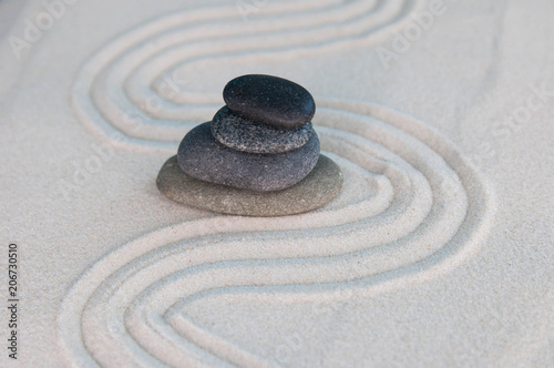 Fotobehang Zen Pyramids of gray zen stones on light sand. Concept of harmony, balance and meditation, spa, massage, relax