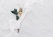 Flat Lay Gold Cutlery With Oli...