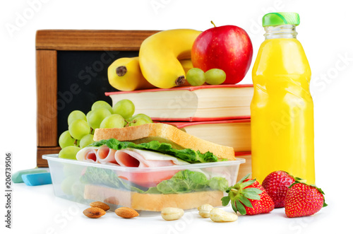 Foto op Aluminium Assortiment school lunch with a sandwich, fresh fruits and juice isolated