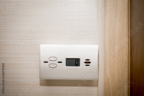 Vászonkép White carbon monoxide sensor mounted on the wall in the bathroom, kitchen