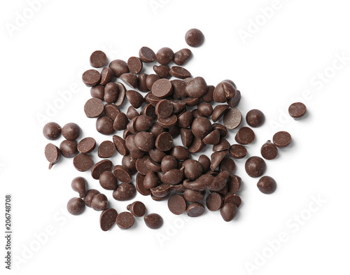 Delicious black chocolate chips on white background