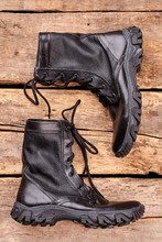 Pair Of Black Army Boots On Wood. Close Up. Flat Lay, Top View.